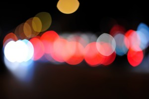 A blurred night time image of car and street lights,