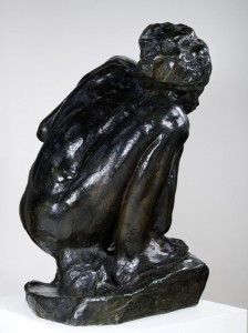 Black and white - newspaper print image of Rodin's bronze cast of crouching lady.
