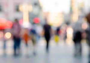 A picture of a town centre, people walking around, blurred so that there is no focus in the image, only colours, shapes and fuzzy things can be seen.
