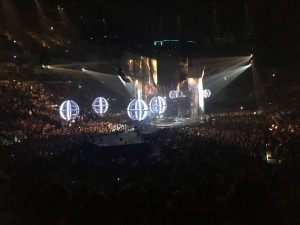 Photo shows view from out seats, it shows the central stage with large lled lit balls attached to drone..... The title of the Tour