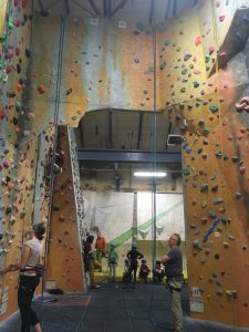 Image showing climbing walls with competitors in the background around the bouldering problems