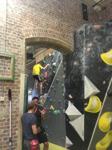 Image shows climbing walls between and around original brick features of the water pumping station