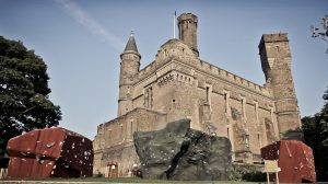 Exterior image of The Castle Climbing Centre, showing the 3 tall towers of this previous water pumping station, part of the original design that gave it its name as a castle