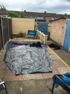 Image shows ground sheet laid out on garden patio
