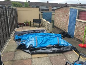 Image of the outer tent laid out flat on the patio ready to assemble