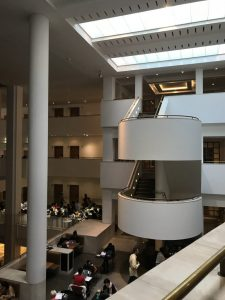 Photograph shows rounded stairwells and the skylights again from inside The British Library
