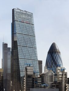 An image of the London Skyline, showing The Cjeesegrater with The Gherkin to the right and The Lloyds building in the foreground.