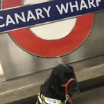Canary Wharf Roundell with Guide Dog sat in front of it in her guide dog harness.